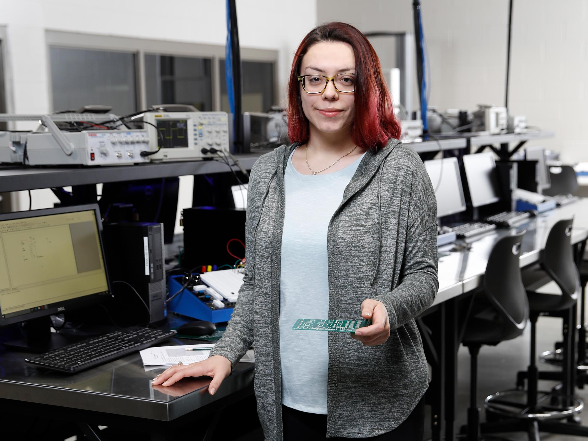 Female student working on automated computer interface