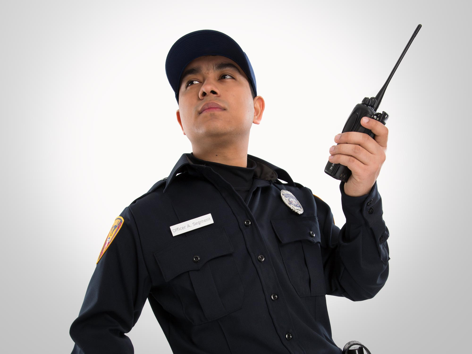 Male student in police uniform with walkie talkie
